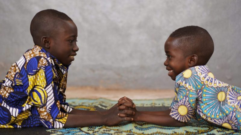 peace building African children holding hands